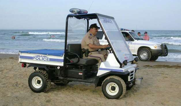 The South Padre Island police were out patroling the beaches at South Padre Island, Texas on Friday, March 9, 2001.  Most of the spring breakers hang out at the beach behind the Radisson Hotel. Photo: JOE HERMOSA, AP / THE BROWNSVILLE HERALD