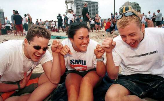 "SMU students Chris Epp, Tara Comfort and John Hemphill play a game on the beach during the first official day of ""Texas Week"" on South Padre Island, Texas, on Saturday March 10, 2001. Cold weather kept many out of the water, but students still flocked to the beach to play. Over 100,00 students are expected on the island for Spring Break.  SPECIAL TO EXPRESS-NEWS / Photo by Alicia J. Wagner Photo: Alicia J. Wagner, Freelance"