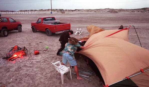 Chance Mock,18, of Houston and Del Mar College student Jeff Voris, right, 26, of Corpus Christi help friends take down a tent as a storm blows in near JP Luby Surf Park on North Padre Island Tuesday, March 14, 2000. Photo: MICHELLE CHRISTENSON, AP / CORPUS CHRISTI CALLER-TIMES