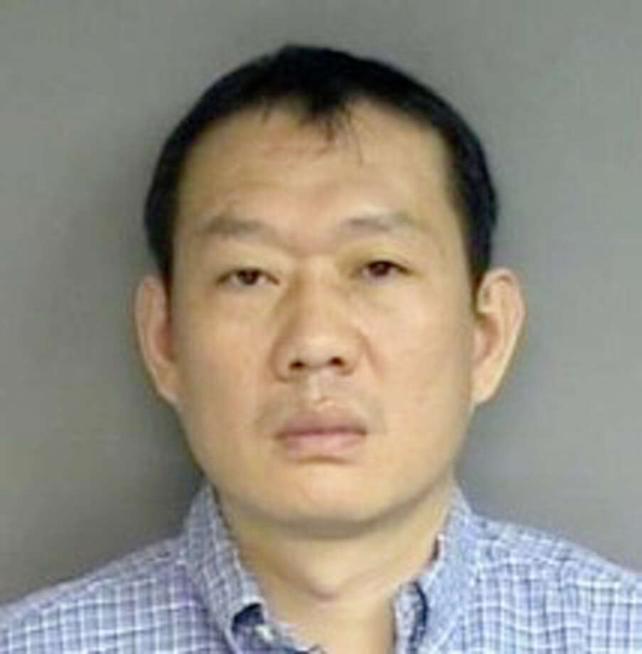 Stamford Police Department booking photo of Guangfu Zhao. Photo: Contributed Photo / Stamford Advocate Contributed