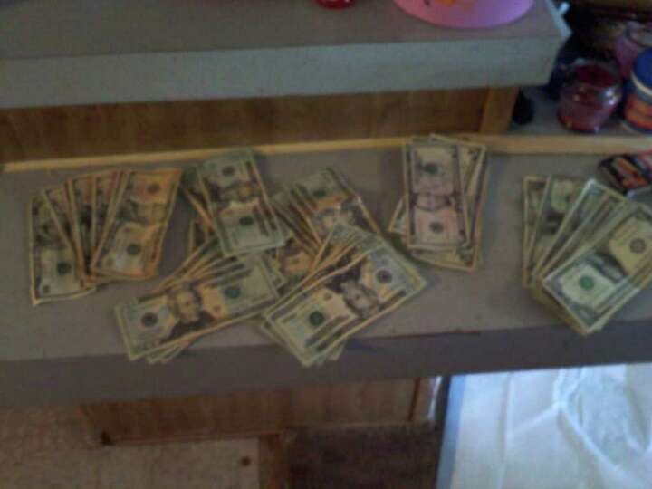 A little over $500 in cash seized during the raid