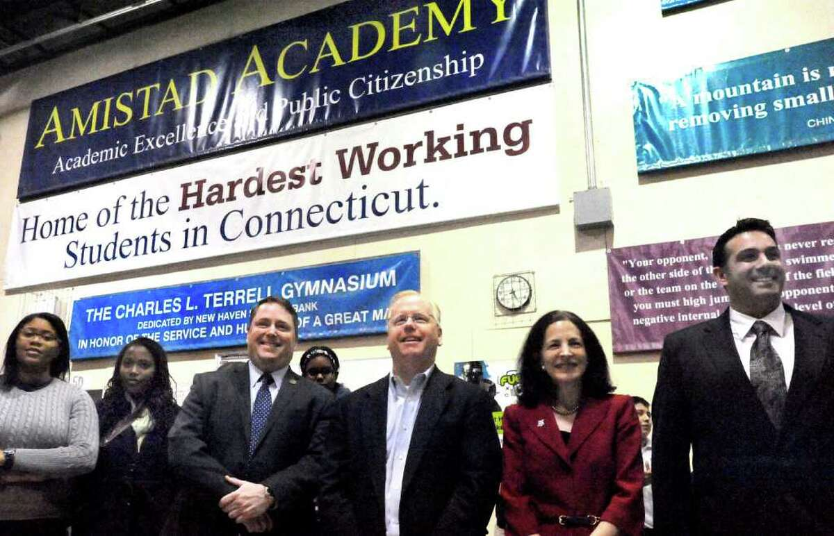 State Rep. Dan Carter, R-Bethel, left center, Danbury Mayor Mark Boughton, center, State Rep. Gail Laviello, R-Wilton, and Frank Santora pastor of Faith Church in New Milford, right, observe students and teachers participating in Morning Circle at Amistad Academy Middle School in New Haven, Friday, Feb. 18, 2011.