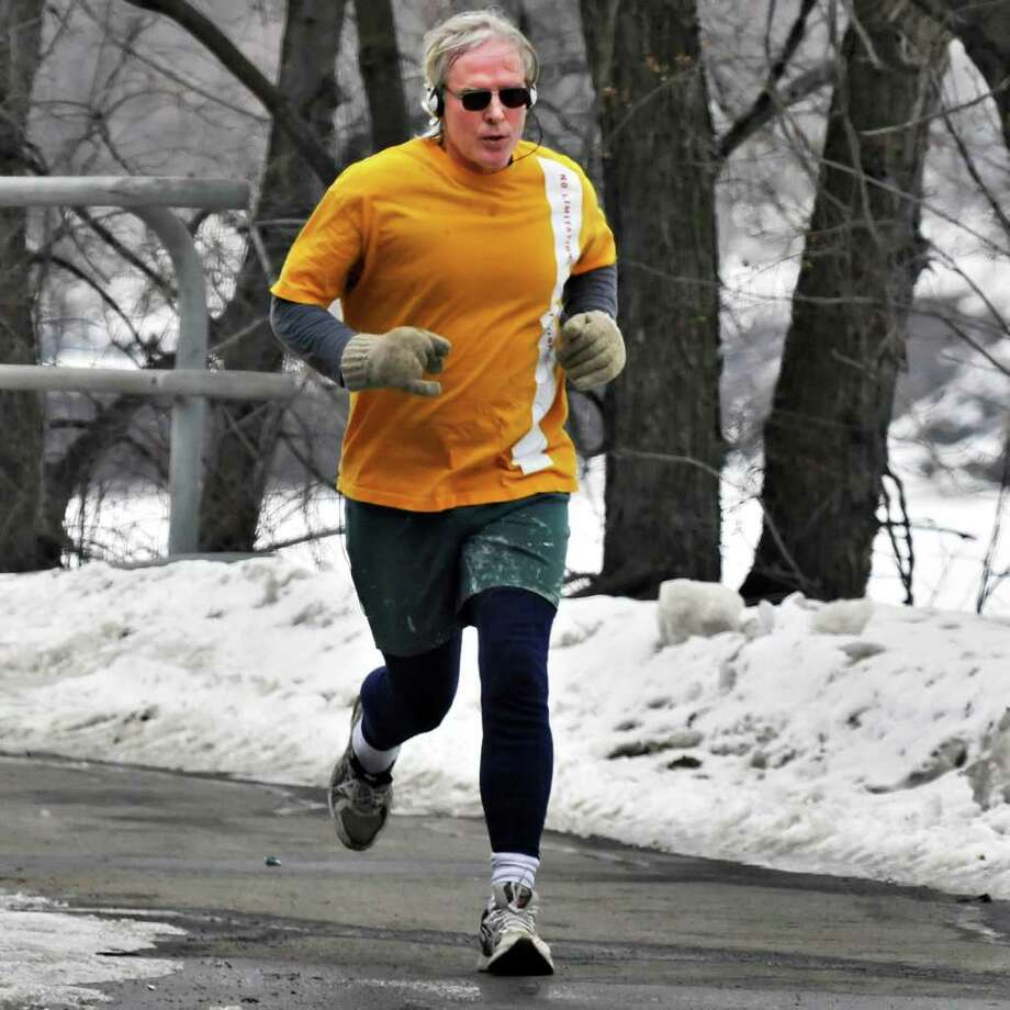 John Gaffey of Guilderland gets in a lunchtime run at Albany?s Corning Preserve Thursday ? at least while the weather cooperates. Friday promises to be harsher. National Weather Service meteorologists say snow will begin to move into the area between 4 and 7 a.m., with chances of sleet and rain increasing in areas west of Albany and southern Saratoga County.  (John Carl D'Annibale / Times Union) Photo: John Carl D'Annibale / 00012186A