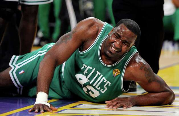 Boston Celtics center Kendrick Perkins lies on the floor after apparently suffering an injury during the first half of Game 6 of the NBA basketball finals against the Los Angeles Lakers on Tuesday, June 15, 2010, in Los Angeles. (AP Photo/Mark J. Terrill) Photo: Mark J. Terrill, STF