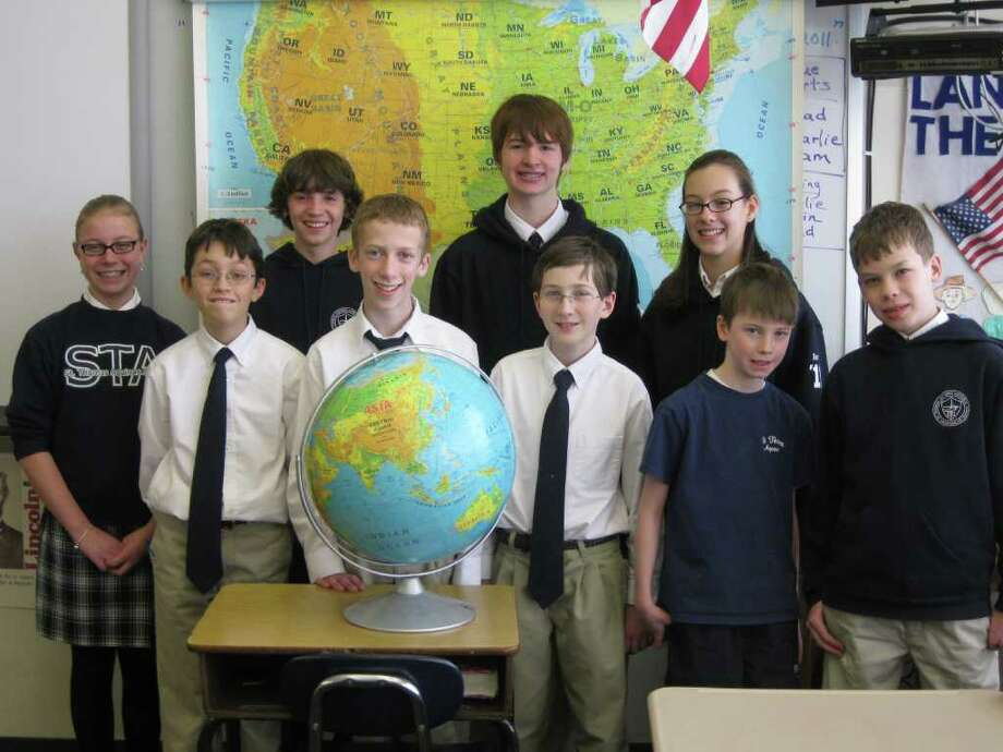 Finalists in this year's Geography Bee at St. Thomas Aquinas School in Fairfield are, from left: Grace Donelan, Max Moeser, current school champion Peter Campbell, Hugh Foley, Brendon Reed (second place), Ryan Cimmino, Samantha Dunn, Liam Day (third place) and Thomas Wiig. Photo: Contributed Photo / Fairfield Citizen contributed
