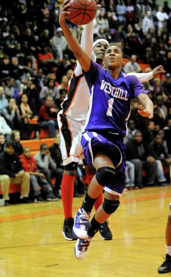 Stamford's Jakai Wilson and Westhill's Tony Dobbinson during Westhill @ Stamford boys basketball in Stamford, Conn. on Monday February 14, 2011. The score was Stamford 55 Westhill 49 Photo: Dru Nadler, ST / Stamford Advocate Freelance