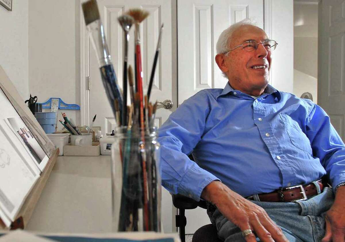 Former Times Union political cartoonist Hy Rosen sits in the art studio of his home in Loudonville on Feb. 28, 2006. Rosen, who died Thursday at 88, worked at the paper from the 1940s to 1990s.(Lori Van Buren/ Times Union)