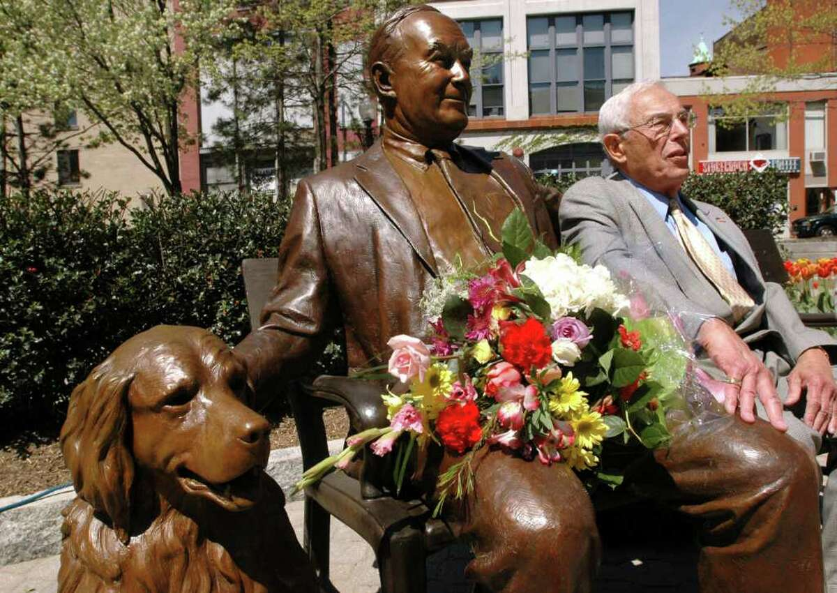 Sculptor Hy Rosen sits on the bench next to his statue of former Albany Mayor Thomas M. Whalen III and his dog Finn following a dedication of the statue May 5, 2005, at Tricentennial Park in Albany. Rosen, 88, who was a longtime poltical cartoonist for the Times Union, died Thursday. (Cindy Schultz / Times Union archive)