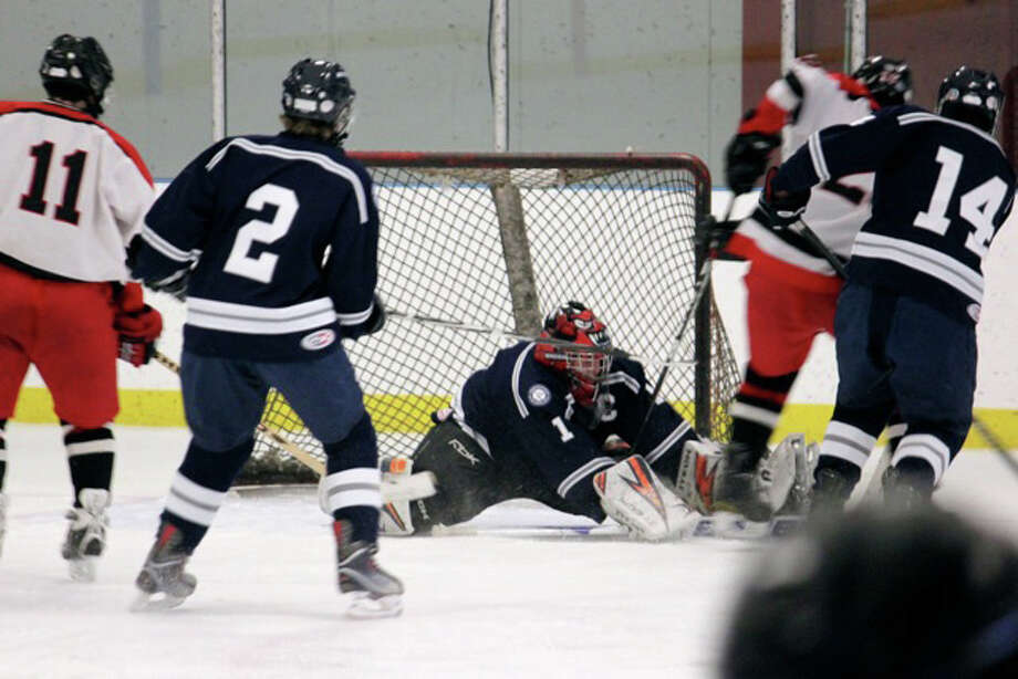 Fairfield trys to score on Staples senior captain Mark Blake-Lobb Thursday. Although Blake-Lobb made 27 saves, the Mustangs outplayed the Wreckers and won, 6-4. Photo: Contributed Photo / Anna Andriuk