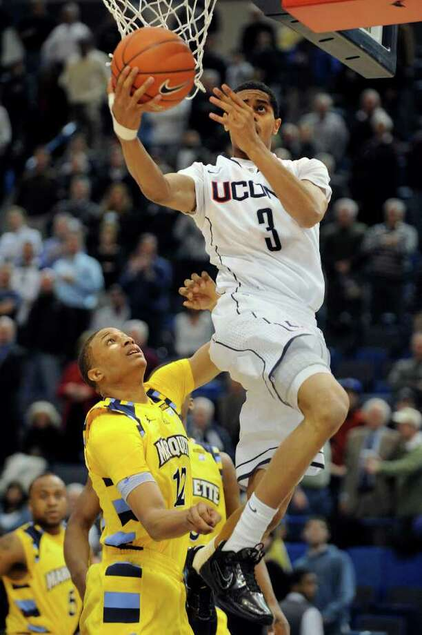 Connecticut's Jeremy Lamb, right, drives to the basket while being guarded by Marquette's Erik Williams during the first half of an NCAA college basketball game in Hartford, Conn., on Thursday, Feb. 24, 2011. (AP Photo/Fred Beckham) Photo: Fred Beckham, ASSOCIATED PRESS / AP2011