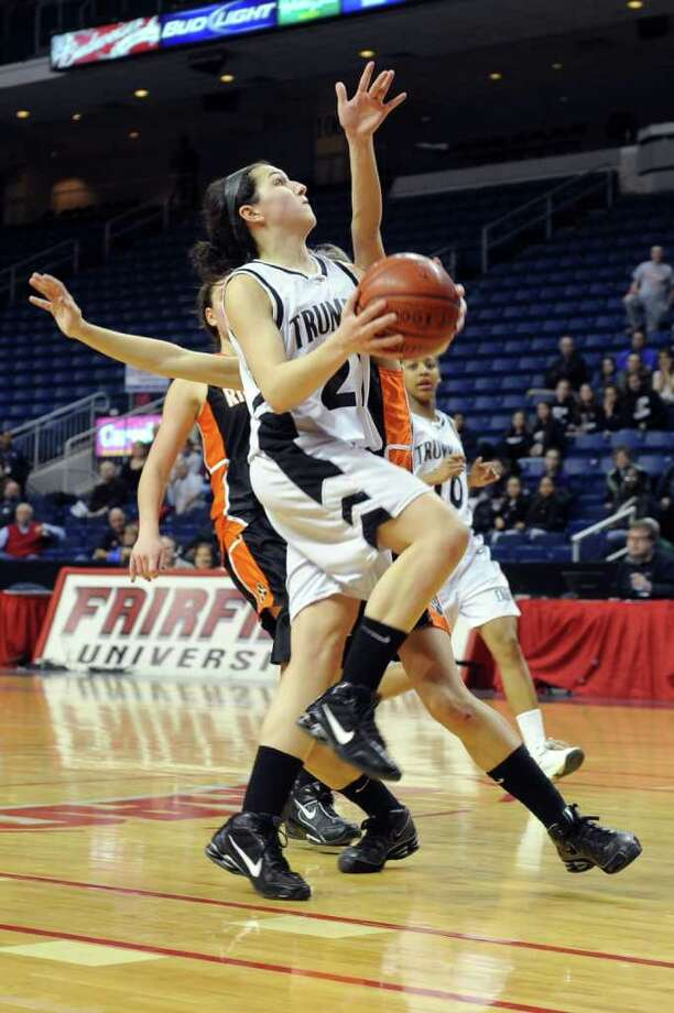 Trumbull's Kelly Coughlin puts up a shot during Thursday's FCIAC girls basketball championship game at Webster Bank Arena at Harbor Yard on February 24, 2011. Photo: Lindsay Niegelberg / Connecticut Post
