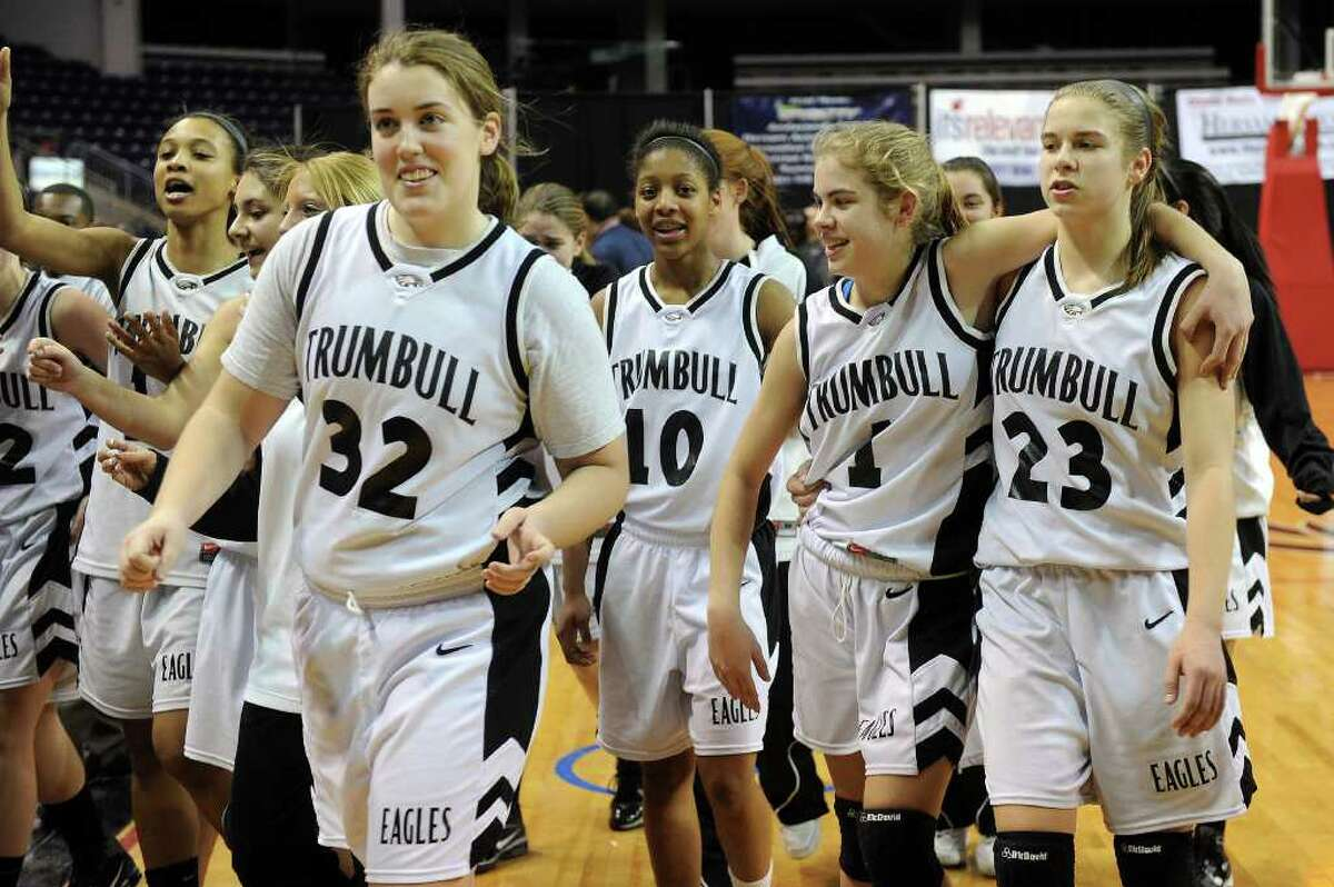 The Trumbull girls basketball team celebrates their win after Thursday's FCIAC girls basketball championship game at Webster Bank Arena at Harbor Yard on February 24, 2011.