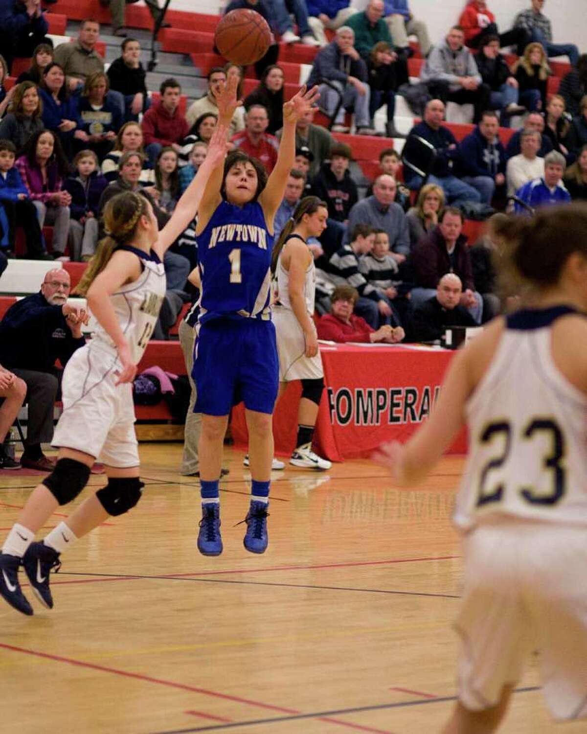 Newtown's Riley Wurtz shoots a jump shot over Lauralton Hall defender Marisa Dowling during the SWC championship game Thursday night at Pomperaug High School.