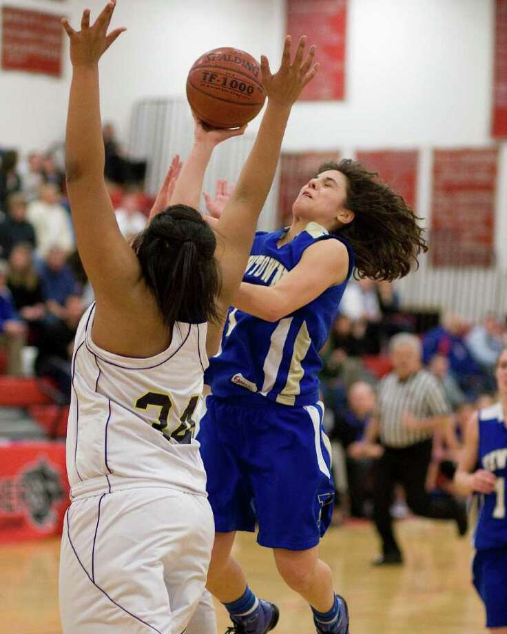 Newtown's Riley Wurtz goes up for a shot over Lauralton Hall's Olivia Levey during the SWC championship game Thursday night at Pomperaug High School. Photo: Barry Horn / The News-Times Freelance