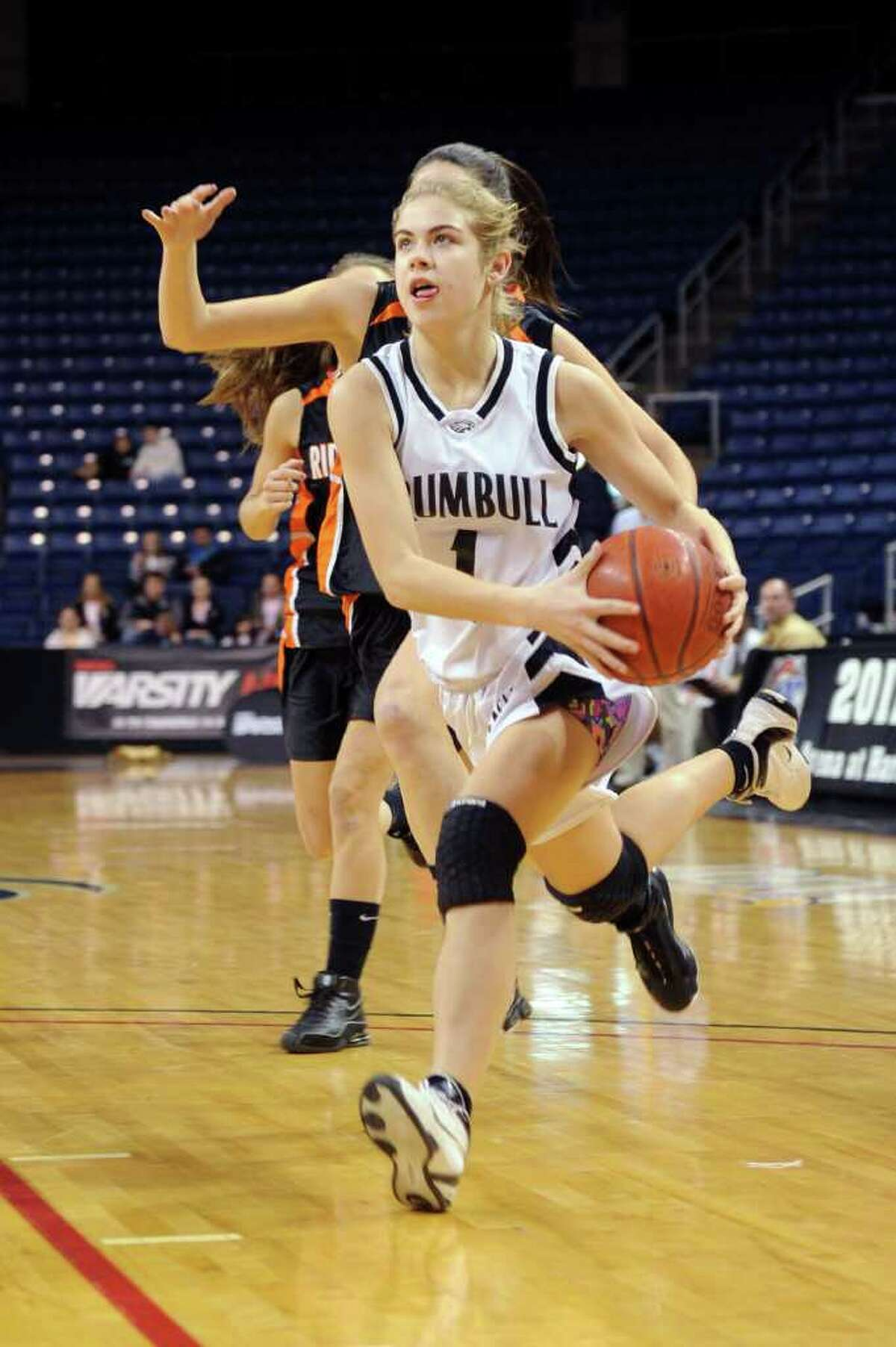 Trumbull's Alexa Pfohl dribbles the ball during Thursday's FCIAC girls basketball championship game at Webster Bank Arena at Harbor Yard on February 24, 2011. Pfohl was named Most Valuable Player after the game.