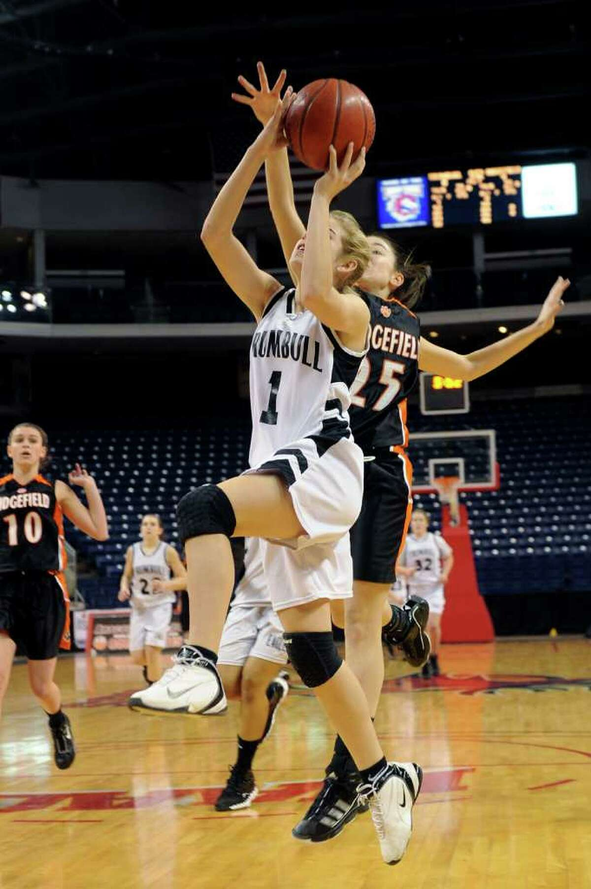Trumbull's Alexa Pfohl puts up a shot as Ridgefield's Molly Welch defends during Thursday's FCIAC girls basketball championship game at Webster Bank Arena at Harbor Yard on February 24, 2011. Pfohl was named Most Valuable Player after the game.