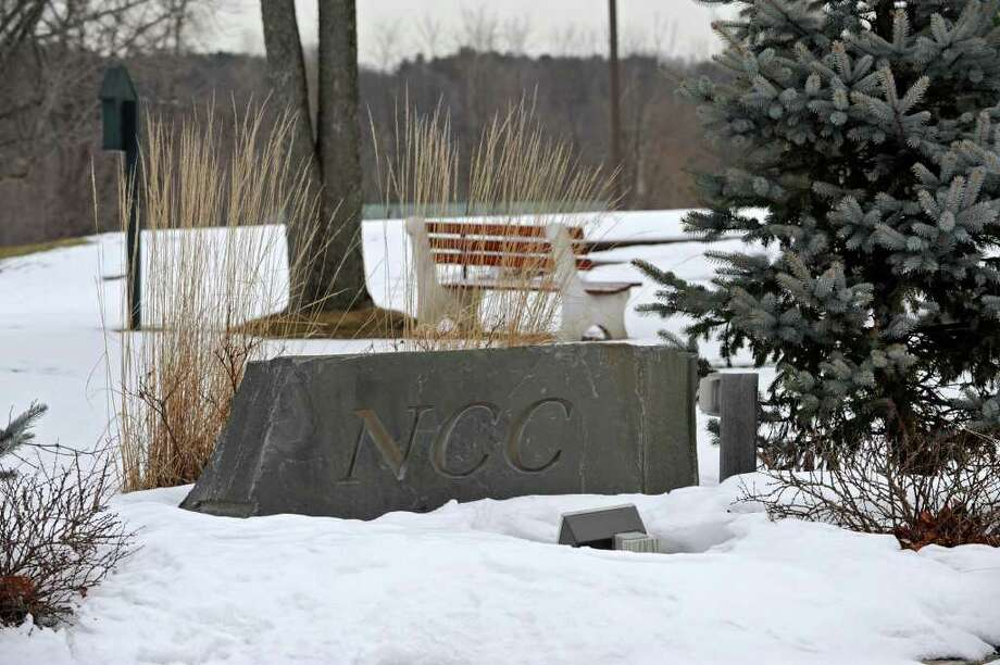 A rock with the initials for Normanside Country Club engraved into it is displayed near the clubhouse at the course in Delmar, NY on Thursday, February 24, 2011.  (Lori Van Buren / Times Union) Photo: Lori Van Buren