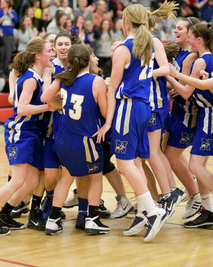 Newtown girls celebrate winning the SWC championship over Lauralton Hall thursday night at Pomperaug High School. Photo: Barry Horn / The News-Times Freelance