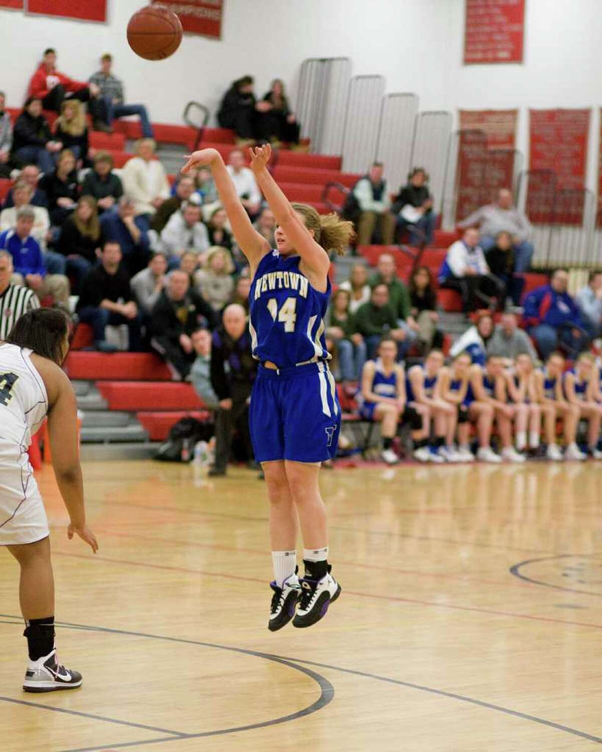 Newtown's Maddy Good shots a jump shot against Lauralton Hall in the SWC championship game Thursday night at Pomperaug High School.