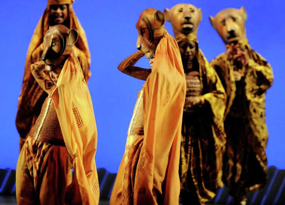 A cast performs in the Lioness Hunt during