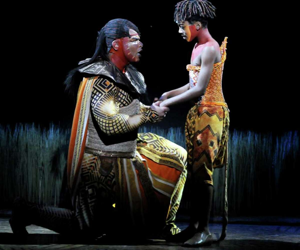 """Dionne Randolph, as Mufasa, left, sings """"They Live in You"""" to Jerome Stephens Jr., as Mufasa's son Simba, during """"The Lion King"""" on Thursday, Feb. 24, 2011, at Proctors Theatre in Schenectady, N.Y. (Cindy Schultz / Times Union)"""
