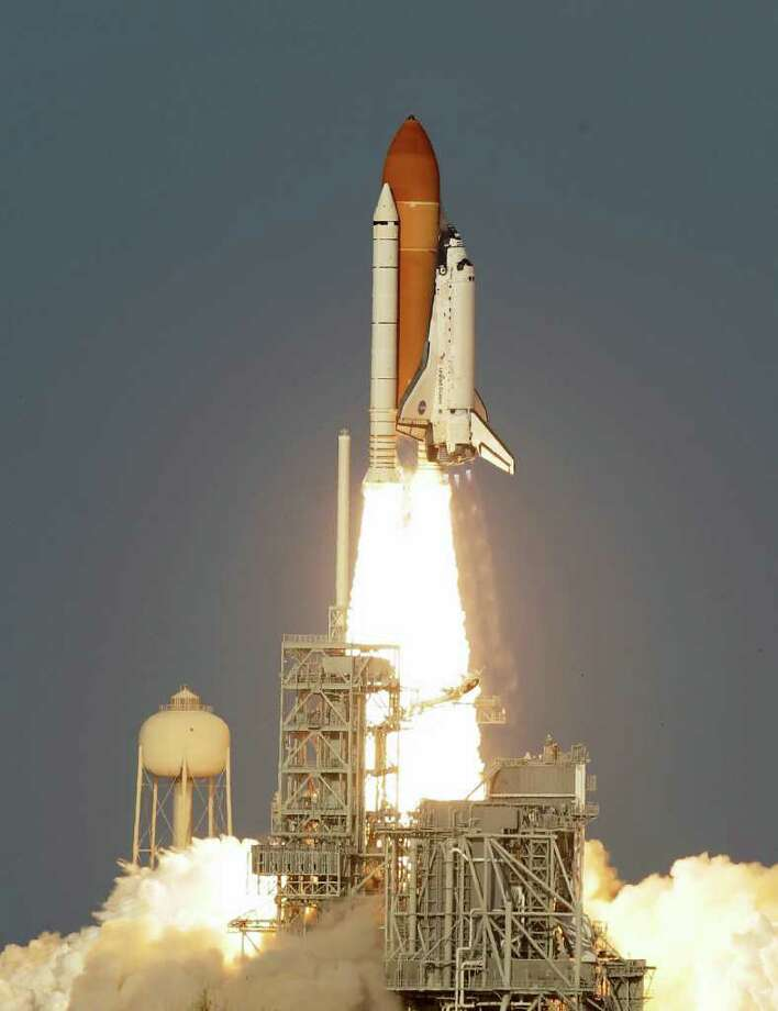 Space shuttle Discovery lifts off from Pad 39A at the Kennedy Space Center in Cape Canaveral, Fla., Thursday, Feb. 24, 2011. Discovery on its last mission, will carry the Leonardo Permanent Multipurpose Module, or PMM, to the International Space Station. AP Photo/John Raoux) Photo: John Raoux