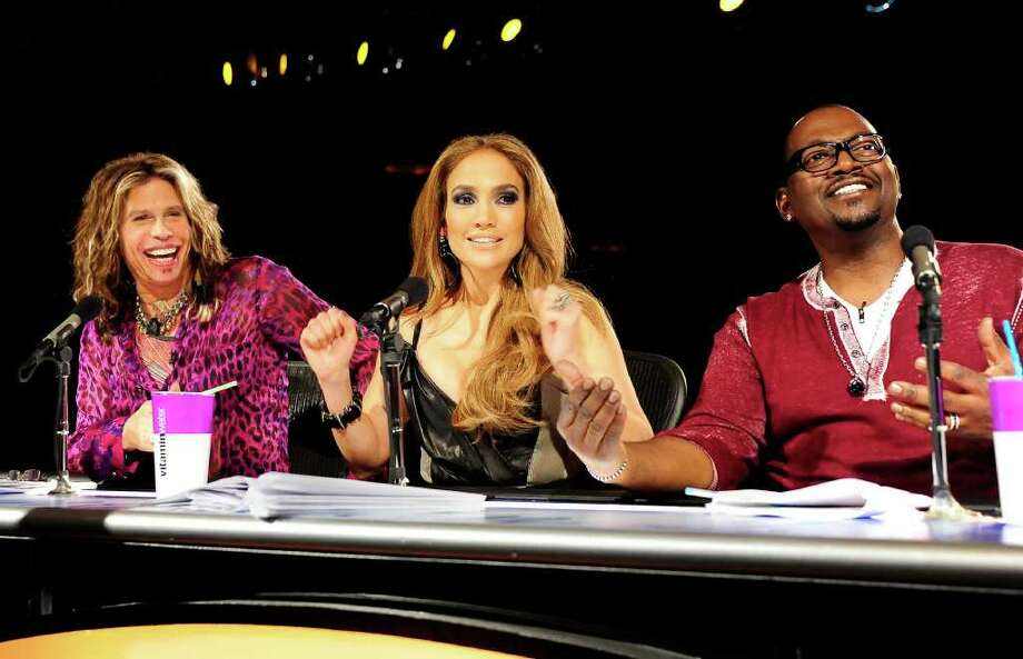 "In this undated publicity image released by Fox, ""American Idol"" judges, from left, Steven Tyler, Jennifer Lopez and Randy Jackson are shown during Hollywood Week in Los Angeles. Viewers will be able to cast votes through Facebook, along with the previous options of phone and text message, when the singing contest shifts from judges' to audience's choice next Tuesday. (AP Photo/Fox, Michael Becker) Photo: Michael Becker"