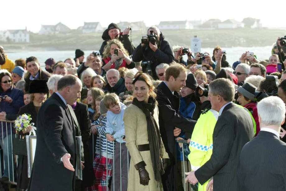 Britain's Prince William and Kate Middleton greet well wishers after after naming a new lifeboat at the Trearddur Bay Lifeboat Station on the island of Anglesey, Wales, Thursday, Feb. 24, 2011. The visit had been highly anticipated because the couple have kept such a low profile since announcing their engagement in November, making only one other prior appearance at a charity event. They plan to marry April 29 at Westminster Abbey with just under 2,000 guests attending.(AP Photo/Jon Super). Photo: JON SUPER / AP