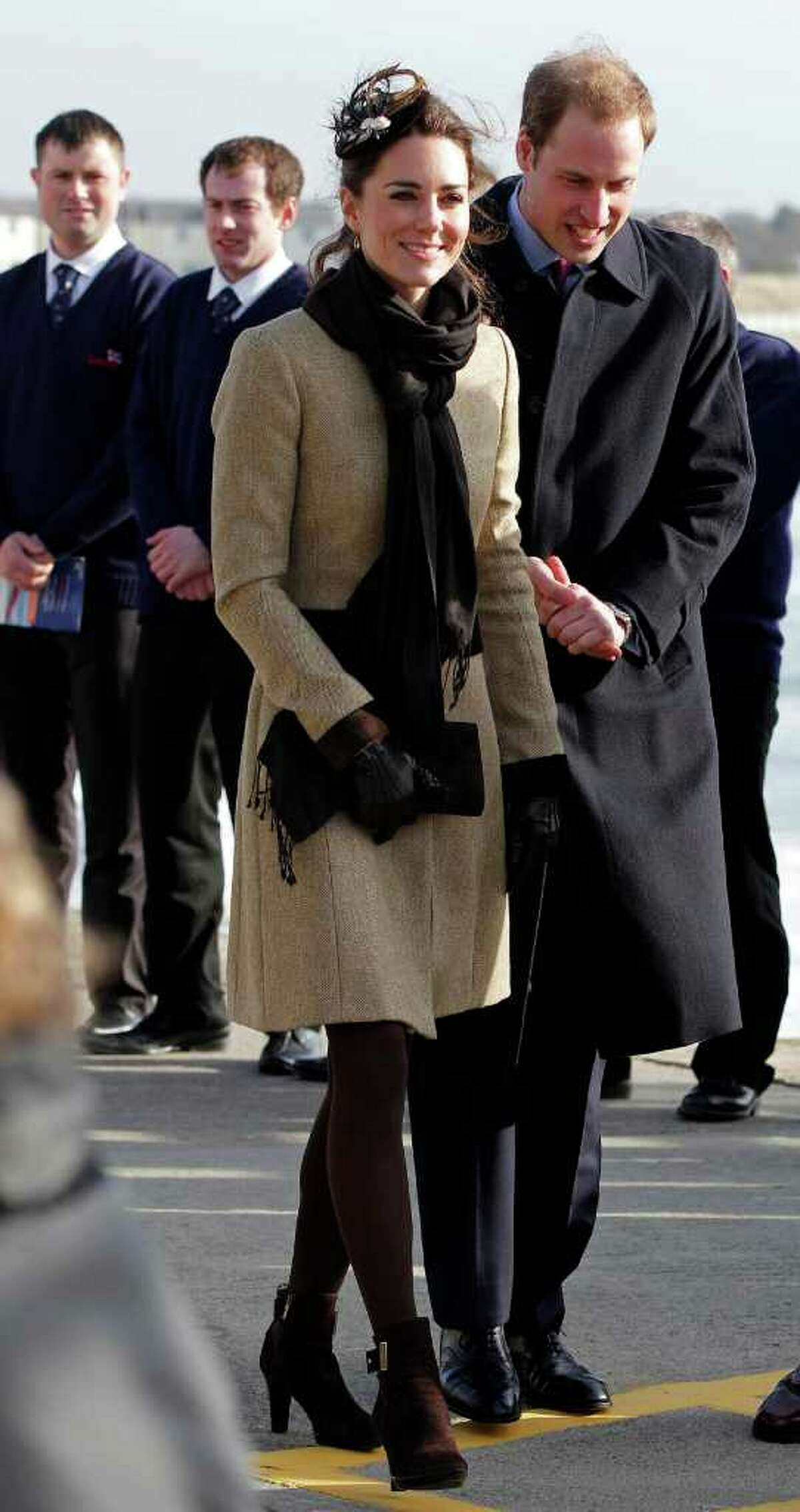 Britain's Prince William and his fiance Kate Middleton attend a naming ceremony and Service dedication for the Royal National Lifeboat Institution's new Atlantic 85 Lifeboat, at Trearddur Bay Lifeboat Station in Anglesey, Wales, Thursday Feb. 24, 2011. The visit had been highly anticipated because the couple have kept such a low profile since announcing their engagement in November, making only one other prior appearance at a charity event. They plan to marry April 29 at Westminster Abbey with just under 2,000 guests attending. (AP Photo/Phil Noble, Pool)