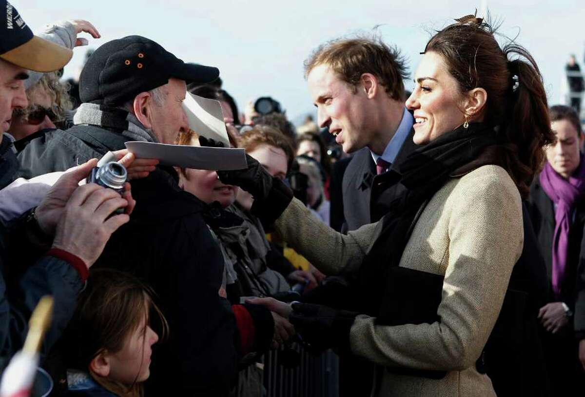 Britain's Prince William and his fiance Kate Middleton meet members of the public, during a naming ceremony and Service dedication for the Royal National Lifeboat Institution's new Atlantic 85 Lifeboat, at Trearddur Bay Lifeboat Station in Anglesey, Wales, Thursday Feb. 24, 2011. The visit had been highly anticipated because the couple have kept such a low profile since announcing their engagement in November, making only one other prior appearance at a charity event. They plan to marry April 29 at Westminster Abbey with just under 2,000 guests attending. (AP Photo/Phil Noble, Pool)