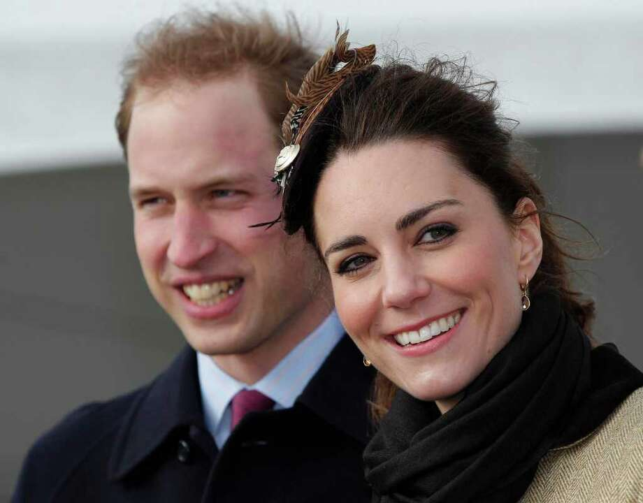 Britain's Prince William and his fiance Kate Middleton react following a naming ceremony and Service dedication for the Royal National Lifeboat Institution's new Atlantic 85 Lifeboat, at Trearddur Bay Lifeboat Station in Anglesey,  Wales, Thursday Feb. 24, 2011. The visit had been highly anticipated because the couple have kept such a low profile since announcing their engagement in November, making only one other prior appearance at a charity event. They plan to marry April 29 at Westminster Abbey with just under 2,000 guests attending.  (AP Photo/Phil Noble, Pool) Photo: PHIL NOBLE / POOL REUTERS