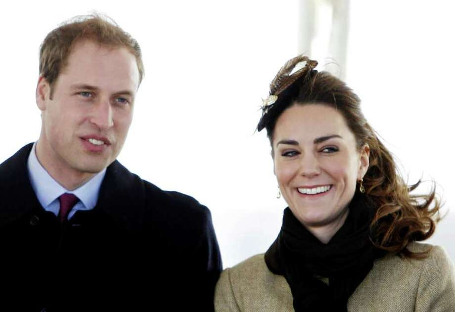 Britain's Prince William and Kate Middleton arrive at a service of dedication for a new RNLI lifeboat at Trearddur Bay Lifeboat Station in Anglesey,  Wales, Thursday Feb. 24, 2011. The visit had been highly anticipated because the couple have kept such a low profile since announcing their engagement in November, making only one other prior appearance at a charity event. They plan to marry April 29 at Westminster Abbey with just under 2,000 guests attending.(AP Photo/Peter Byrne-pa) UNITED KINGDOM OUT: NO SALES: NO ARCHIVE: Photo: Peter Byrne / PA
