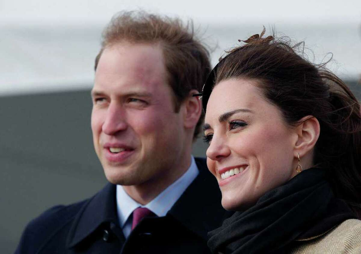 Britain's Prince William and his fiance Kate Middleton react following a naming ceremony and Service dedication for the Royal National Lifeboat Institution's new Atlantic 85 Lifeboat, at Trearddur Bay Lifeboat Station in Anglesey, Wales, Thursday Feb. 24, 2011. The visit had been highly anticipated because the couple have kept such a low profile since announcing their engagement in November, making only one other prior appearance at a charity event. They plan to marry April 29 at Westminster Abbey with just under 2,000 guests attending. (AP Photo/Phil Noble, Pool)
