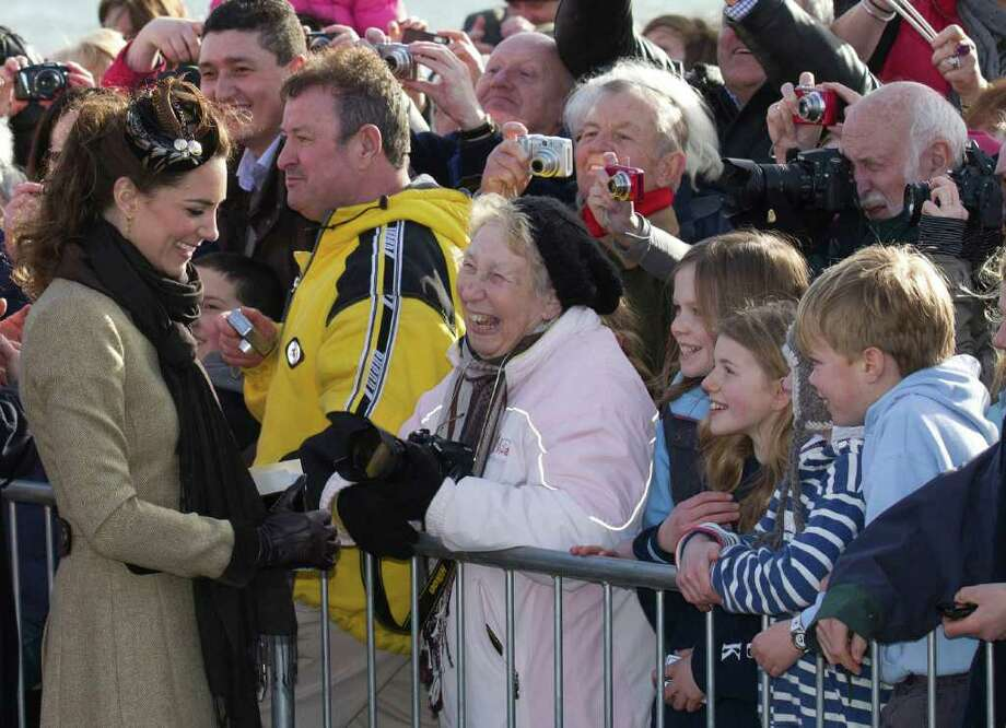 Kate Middleton, the future wife of Prince William greets wellwishers as they visit Trearddur Bay Lifeboat Station on the island of Anglesey, Wales, Thursday, Feb. 24, 2011. After their April 29 wedding the couple will live in North Wales where  William has been since he embarked on a three-year posting as a Search and Rescue helicopter pilot at RAF Valley on Anglesey. (AP Photo/Jon Super). Photo: JON SUPER / AP