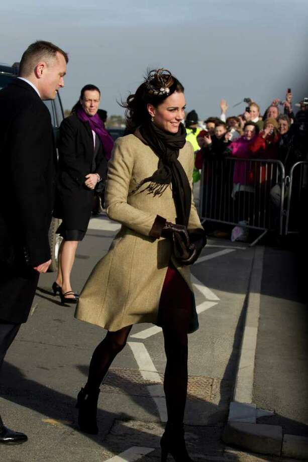Kate Middleton, fiancee to Britain's Prince William, is seen as they visit Trearddur Bay Lifeboat Station on the island of Anglesey, Wales, Thursday, Feb. 24, 2011. Several hundred people cheered as Prince William and fiancee Kate Middleton made a rare public appearance Thursday to dedicate a new lifeboat. They plan to marry April 29 at Westminster Abbey. (AP Photo/Jon Super) Photo: JON SUPER / AP