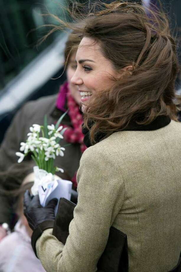 Kate Middleton, fiancee to Britain's Prince William is seen as they visit Trearddur Bay Lifeboat Station on the island of Anglesey, Wales, Thursday, Feb. 24, 2011. Several hundred people cheered as Prince William and fiancee Kate Middleton made a rare public appearance Thursday to dedicate a new lifeboat. They plan to marry April 29 at Westminster Abbey. (AP Photo/Jon Super) Photo: JON SUPER / AP