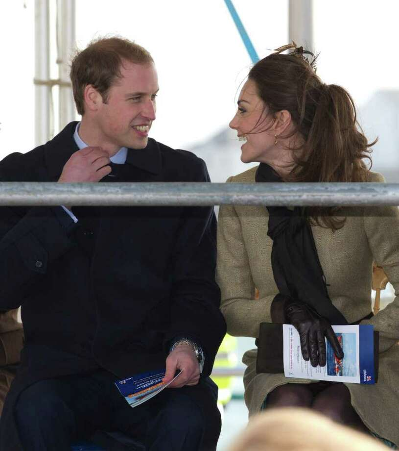 Britain's Prince William, left, is accompanied by his fiancee Kate Middleton as they visit Trearddur Bay Lifeboat Station on the island of Anglesey, Wales, Thursday, Feb. 24, 2011. Several hundred people cheered as Prince William and fiancee Kate Middleton made a rare public appearance Thursday to dedicate a new lifeboat. They plan to marry April 29 at Westminster Abbey. (AP Photo/Jon Super) Photo: JON SUPER / AP