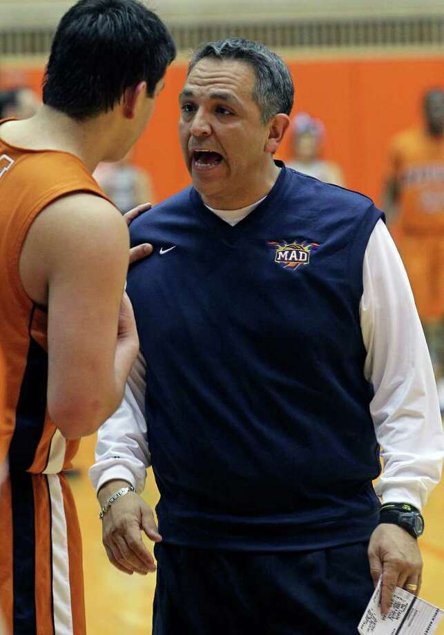 SPORTS   Maverick's coach John Valenzuela talks with a player on the sideline as Clark beats Madison 49-37 in 5A boys basketball playoffs at the UTSA Convocation Center  on February 24, 2011.  Tom Reel/Staff Photo: TOM REEL, SAN ANTONIO EXPRESS-NEWS / © 2011 San Antonio Express-News