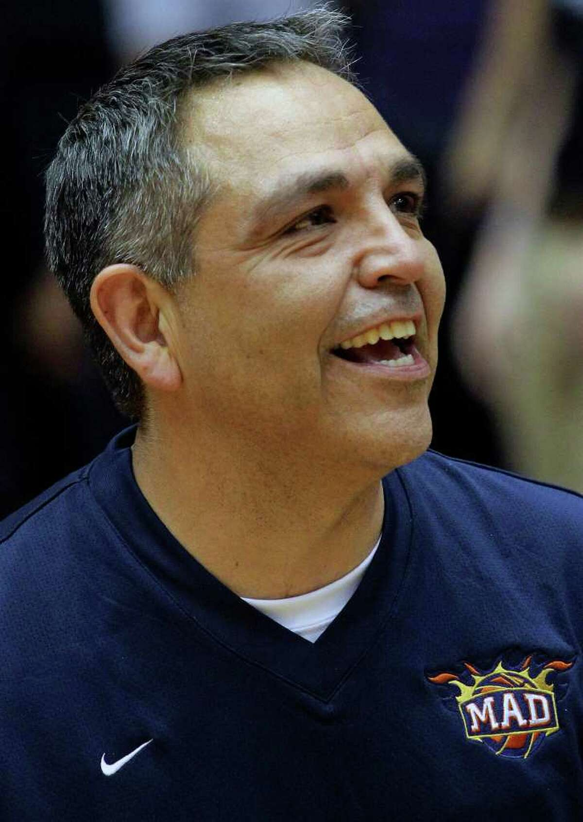SPORTS Madison coach John Valenzuela congratulates opponents after Clark beats Madison 49-37 in 5A boys basketball playoffs at the UTSA Convocation Center on February 24, 2011. Tom Reel/Staff
