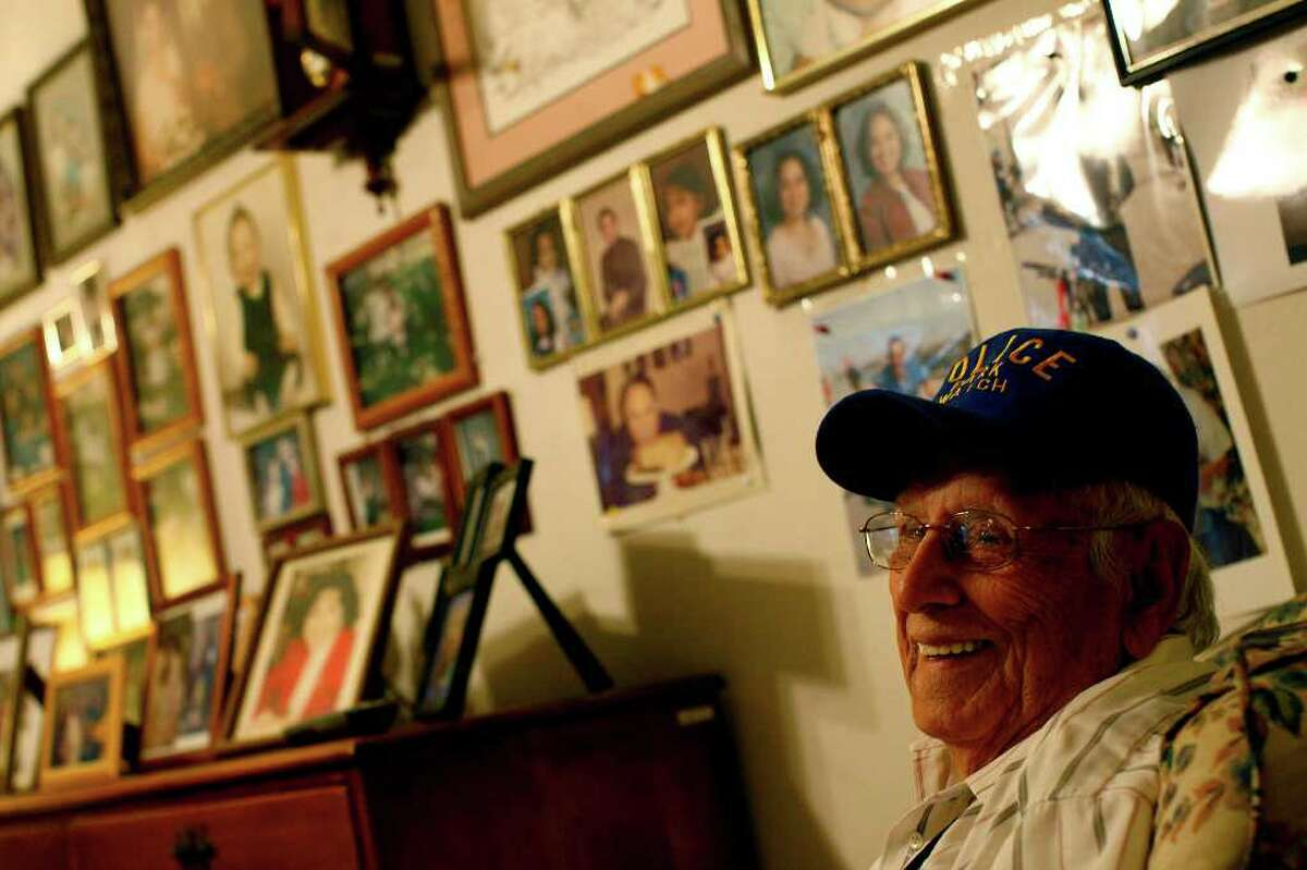 Roy R. Botello, 89, shot some of the last known footage of President John F. Kennedy the night before he was assassinated. Botello, who lives on the West Side, kept the 8 mm film in a drawer in his living room until recently. (Lisa Krantz/Express-News)