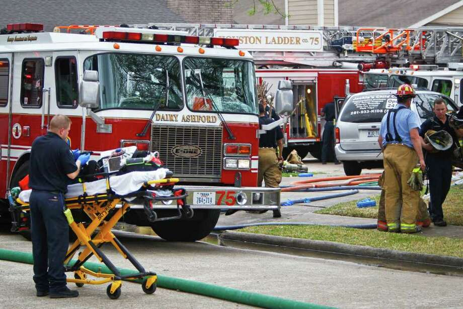 A stretcher is positioned next to a fire truck at the scene of the day-care center fire. The victims ranged in age from 18 months to 3 years old. (Michael Paulsen/Houston Chronicle)