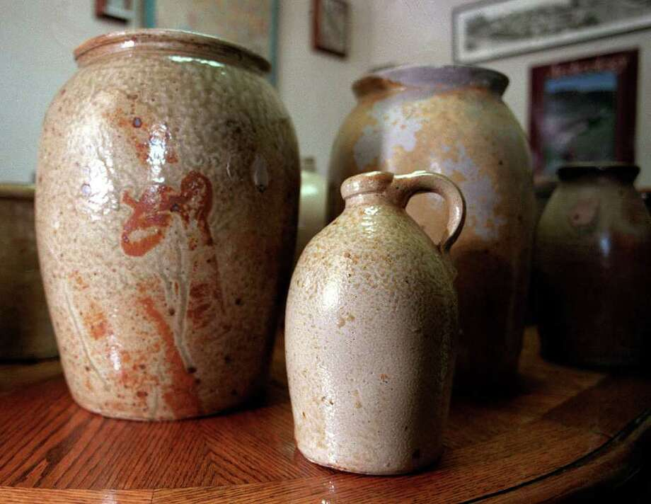 These are some of the Wilson Pottery pieces in Richard Kinz's collection. He volunteers much of his time to excavating the Wilson property and helping create a museum to display it. (Krista Niles/Special to the Express-News)