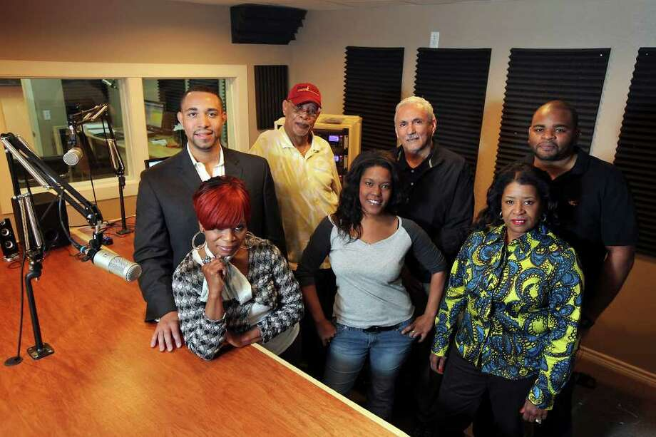 "General manager Tommy Calvert Jr. (back row left to right) Eric Sí, Mario M. Salas and Donnie Dee, and Sheila ""Sasha C"" Campbell (front row left to right), Nneka ""Miss Neka"" Cleaver and Jeré ""JParks"" represent HD station KROV, whose supporters will hold a candlelight ceremony at 5:30 p.m. Sunday at its offices at 1400 West Ave. (Edward A. Ornelas/Express-News) / eaornelas@express-news.net"