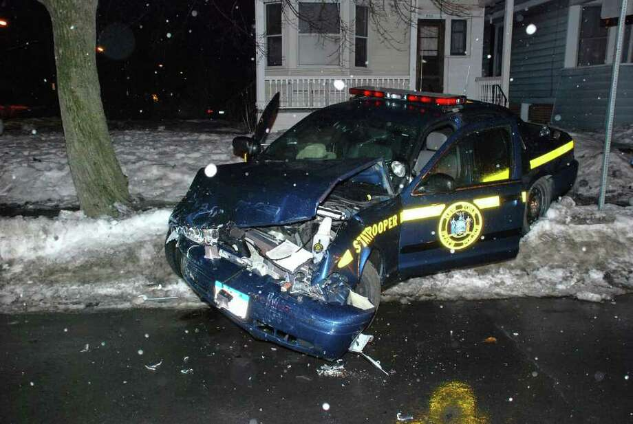 A State Police cruiser was involved in an early morning crash with a taxi at the intersection of Washington Avenue and North Allen Street. The 2 a.m. crash occurred on Friday, Feb. 25, 2011. (Tom Heffernan / Special to the Times Union) Photo: Picasa
