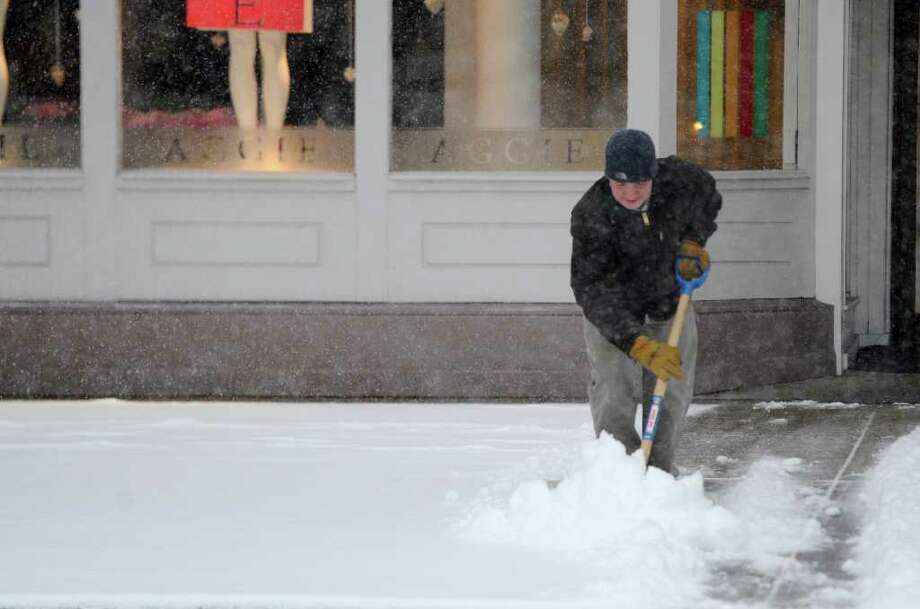 A man who asked that his name not be used moves snow from the sidewalk on Broadway in Saratoga Springs, New York February 25, 2011 as the region is hit with another forecast heavy snowfall.  (Skip Dickstein / Times Union) Photo: SKIP DICKSTEIN / 2008