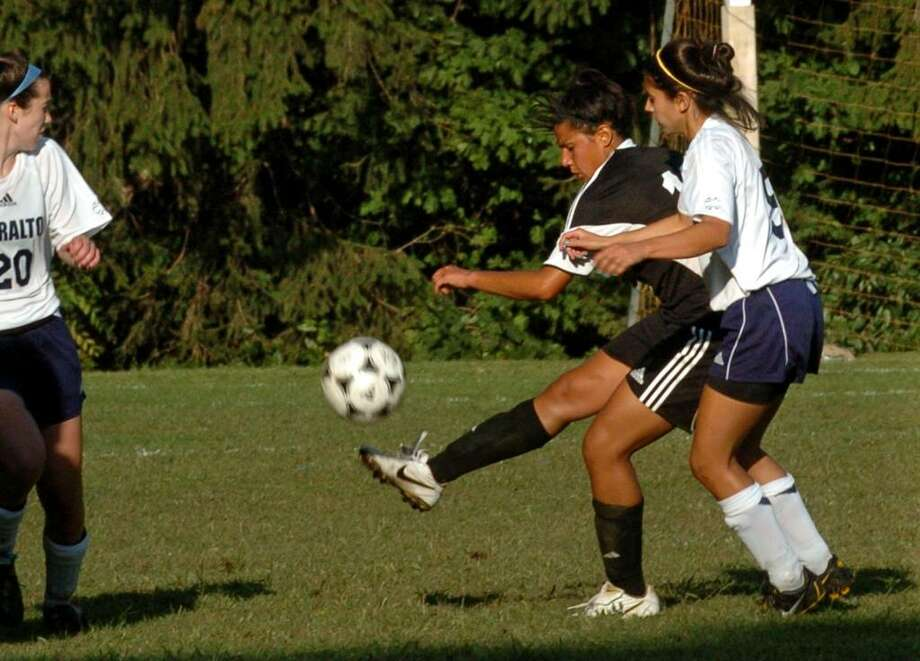 Joel Barlow's #10 Carolina Franco kicks away the ball as Lauralton Hall's #5Erika Sekerak tries to intercept it, during game action in Milford, Conn. on Tuesday Sept. 15, 2009. Lauralton Hall beat Barlow 4-1. Photo: Christian Abraham / Connecticut Post