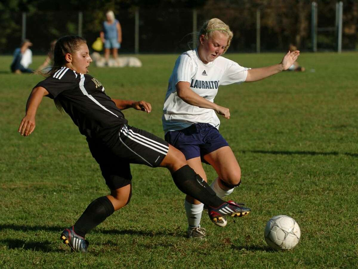 Barlow's #4 MacKenzie Cohane, left, tries to cut off Lauralton Hall's #4 Allison Miles, as she chases down the ball, during game action in Milford, Conn. on Tuesday Sept. 15, 2009.