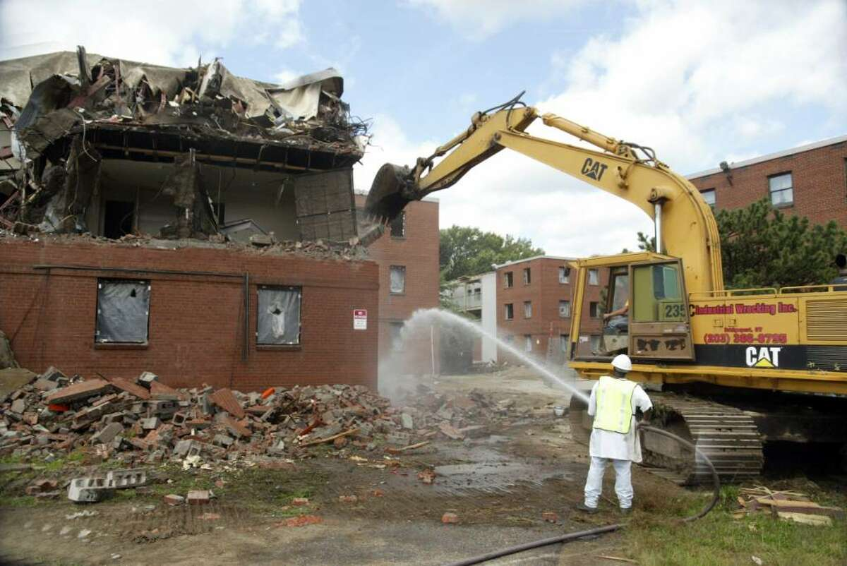 FILE: A crew, from Industrial Wrecking in Bridgeport, begins tearing down Riverside Apartments on Olson Drive in Ansonia.