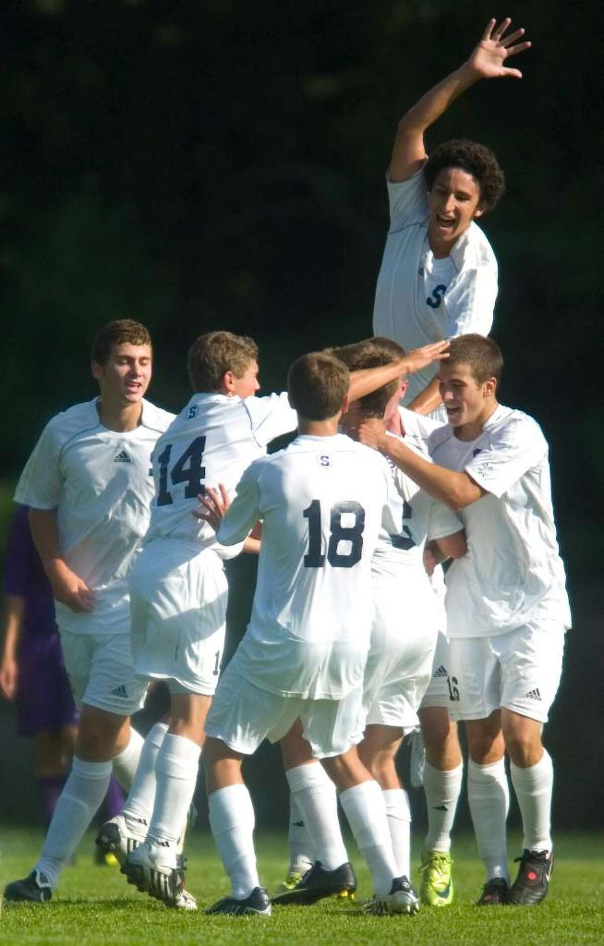 Staples High School players, including Jack Hennessy, top, celebrate after a goal in the first half of an FCIAC soccer match versus Westhill High School at Staples High School in Westport, Conn. on Tuesday, Sept. 15, 2009.
