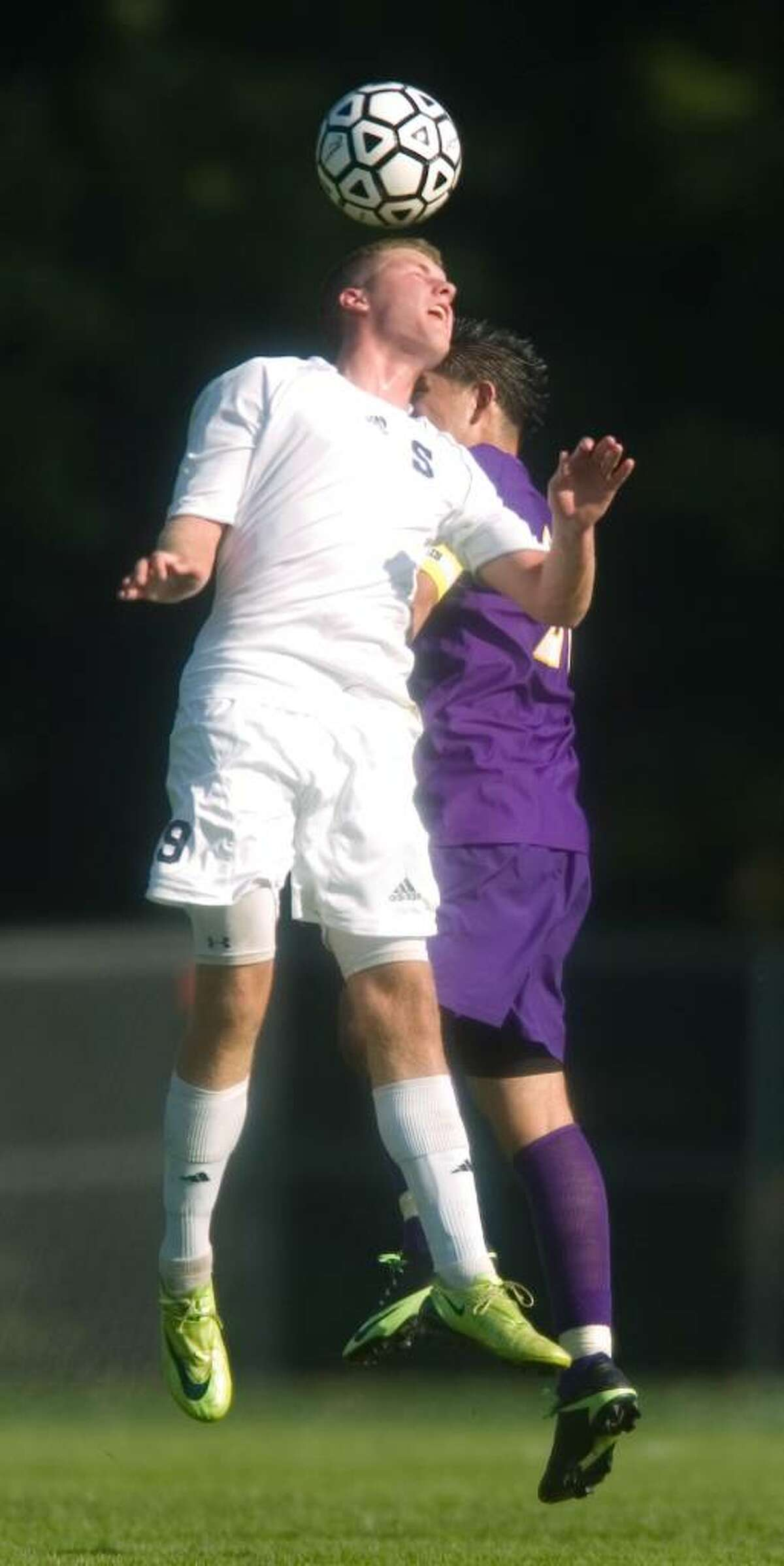 Staples High School player Breandan Lesch goes up for a header during an FCIAC soccer match versus Westhill High School at Staples High School in Westport, Conn. on Tuesday, Sept. 15, 2009.